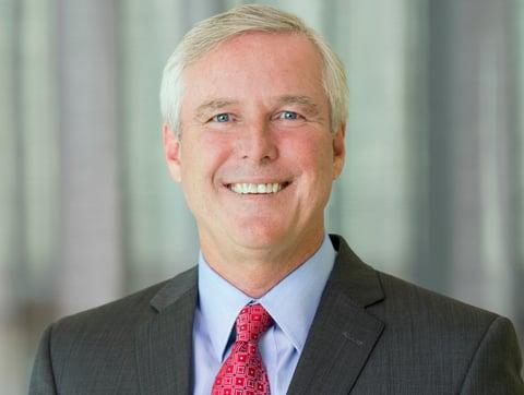 Middle-aged, white executive headshot