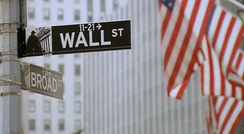 Wall Street sign and flag