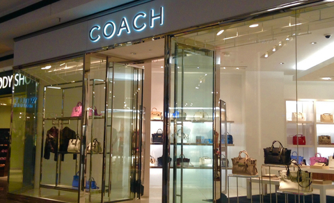 Coach storefront facing a mall