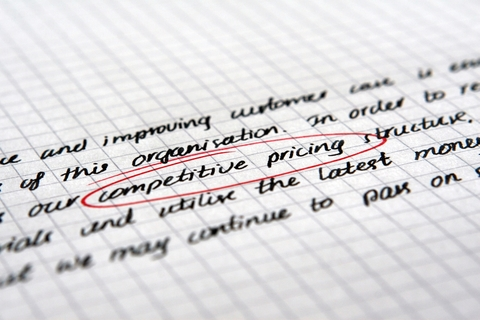 Handwriting on graph paper, indicating competitive pricing