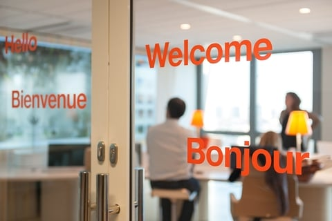 glass office doors with a welcome message