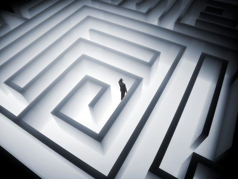 A man trying to find his way through a maze