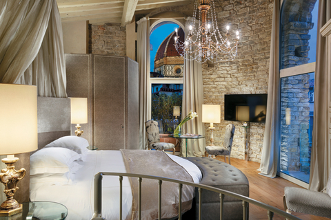 Part of Hotel Brunelleschi is the oldest building in Florence — a tower dating back to the 7th century. Seen here is the Pagliazza Tower Suite.