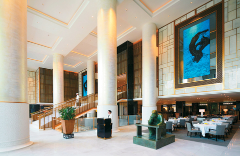 "The Lobby includes 16-foot abstract ink paintings, bronze sculptures of tea drinkers and a hand-carved jade ""Spirit Wall"" just beyond the entrance archway."