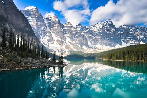 The Rocky Mountains reflected in Moraine Lake in Canada