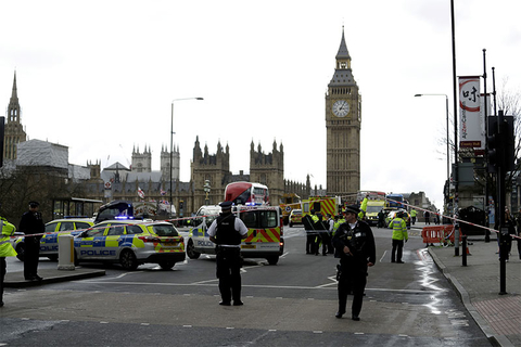 Police secure the area on the south side of Westminster Bridge close to the Houses of Parliament in London.