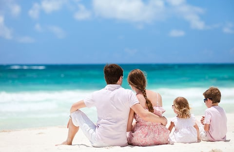Family vacationing on a beach