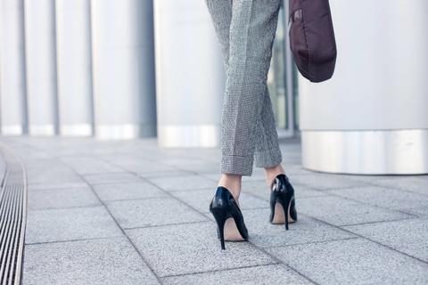 Woman wearing black high heels
