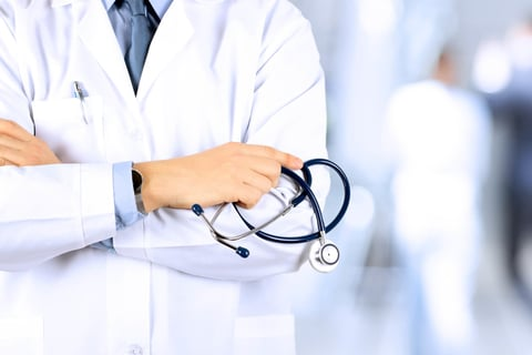 Male doctor in white lab coat