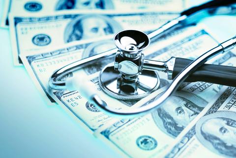 stethoscope on money