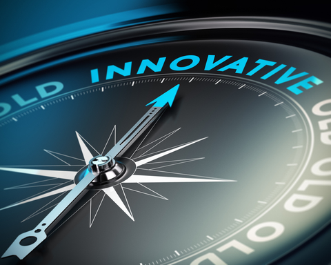 """A compass pointing to the word """"Innovative"""""""