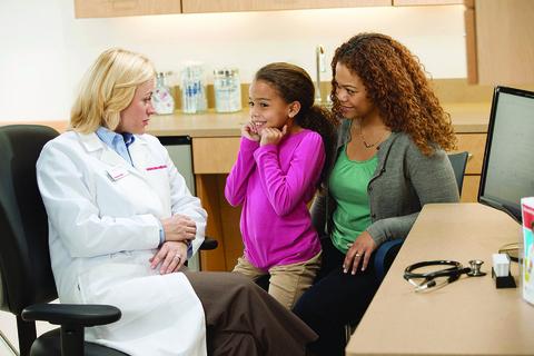Doc treats patients at CVS Health MinuteClinic (USE CREDIT: CVS Health)