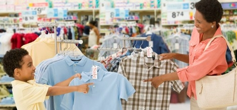 Parent and child school shopping in store.