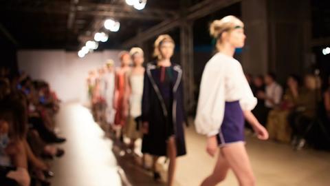 Models walk down a runway at New York Fashion Week