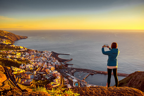 Woman taking photo of Santa Cruz on smartphone
