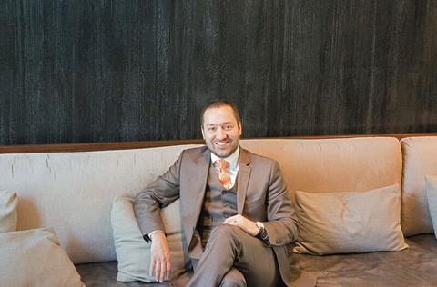 Fernando Gonzalez sitting on a couch