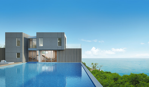 modern house and pool overlooking the sea