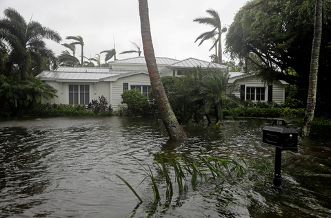 A house is surrounded by water as Hurricane Irma passes through Naples, FL.
