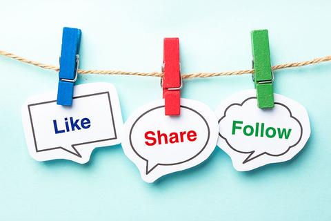 Like share and follow bubbles on a clothesline