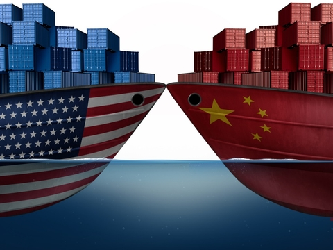 Two boats bearing Chinese, US flags