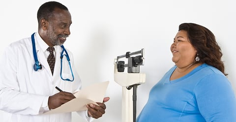 Doctor with patient who is obese