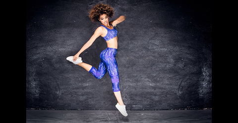 Female Health Club Member Jumping