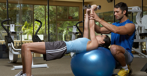 Trainer and client exercising