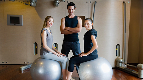 Male Trainer Two Women on Exer Balls