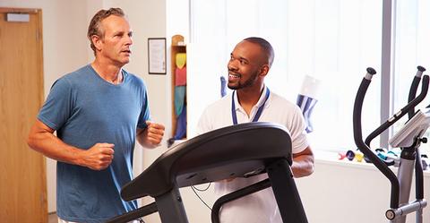 Man on Treadmill with health coach