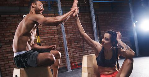 Health club members high five
