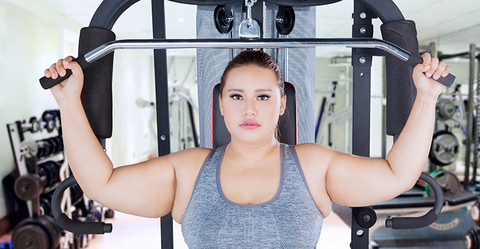 Obese woman strength training