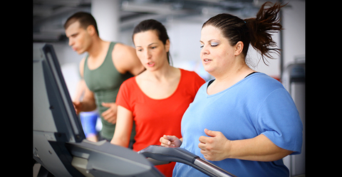 Obese woman running on treadmill