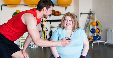 Trainer with client who is obese