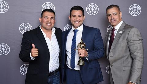 Gold's Gym award recipients Esteban Garcia and Eliud Garcia with Craig Sherwood