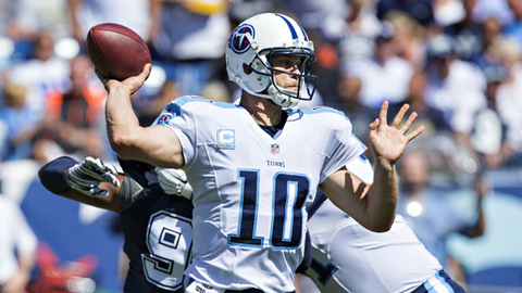 Tennessee Titans quarterback Jake Locker opened the Locker Room fitness center with Tampa Bay Buccaneers punter Michael Koenen in Ferndale WA Photo by Wesley HittGetty Images