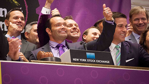 Planet Fitness CEO Chris Rondeau center in purple shirt and tie gives a thumbs up during the company39s initial public offering at the New York Stock Exchange on Aug 6 Photo courtesy Planet Fitness