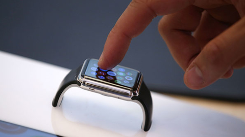 A customer inspects an Apple Watch at the Apple Store on June 17 in San Francisco California Photo by Justin SullivanGetty Images