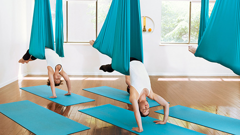 The aerial yoga study commissioned by ACE looked at classes from Unnata Yoga which offers authentic yoga with the support of a soft aerial hammock Michelle Dortignac started Unnata Yoga in 2006 Photo courtesy Unnata LLC