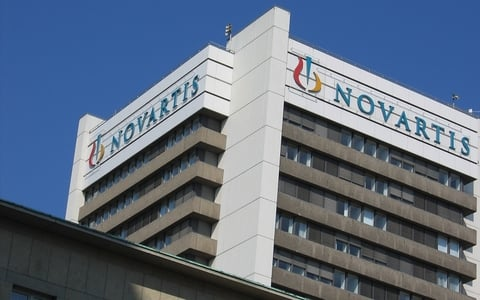 Novartis shares rise amid plans for cancer drug specialist purchase
