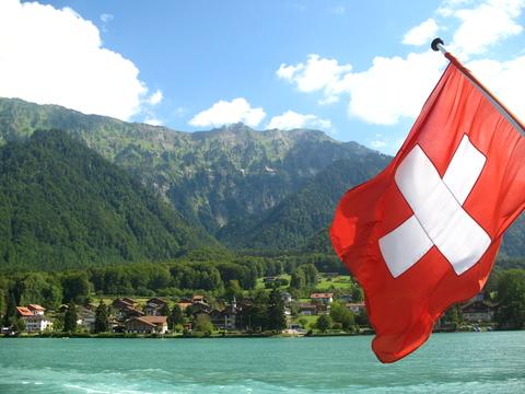 Swiss flag by a lake