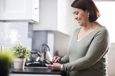 Woman using Livongo diabetes meter