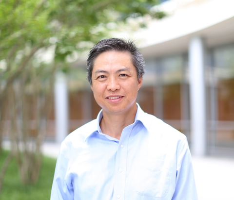 Viela Bio CEO Bing Yao standing outside against an unfocused backdrop of trees and a building