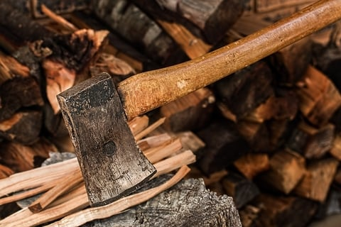 ax splitting wood