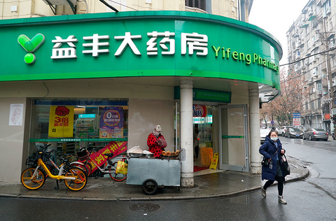 A customer walks out of a Yifeng Pharmacy in Wuhan, China.