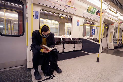 A man wearing a mask on the London Underground due to coronavirus