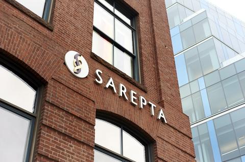 Redbrick building with Sarepta name and logo