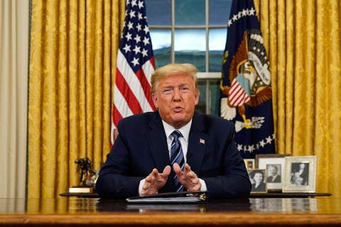 President Donald Trump makes an address from the Oval Office in the White House