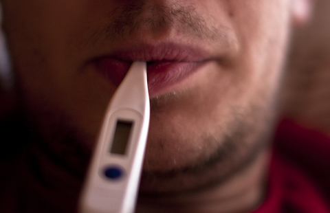 man with thermometer in his mouth