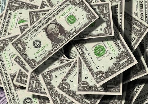 Dollar bills in a pile