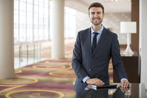 Man standing in a hotel public space